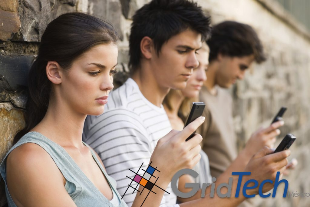 Closeup portrait of young men and women holding cellphone